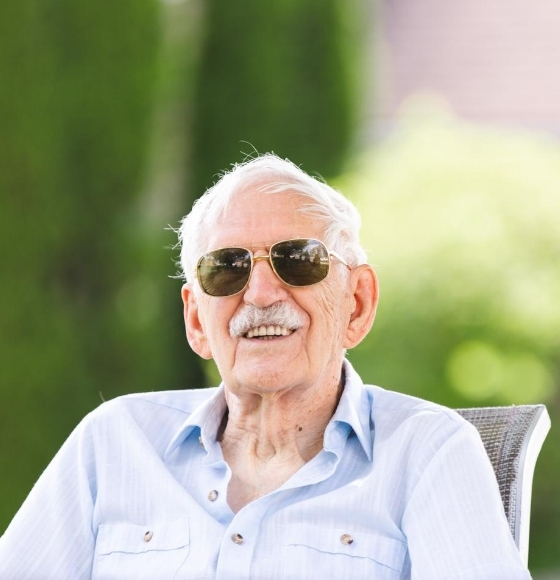 man smiling with sunglasses on
