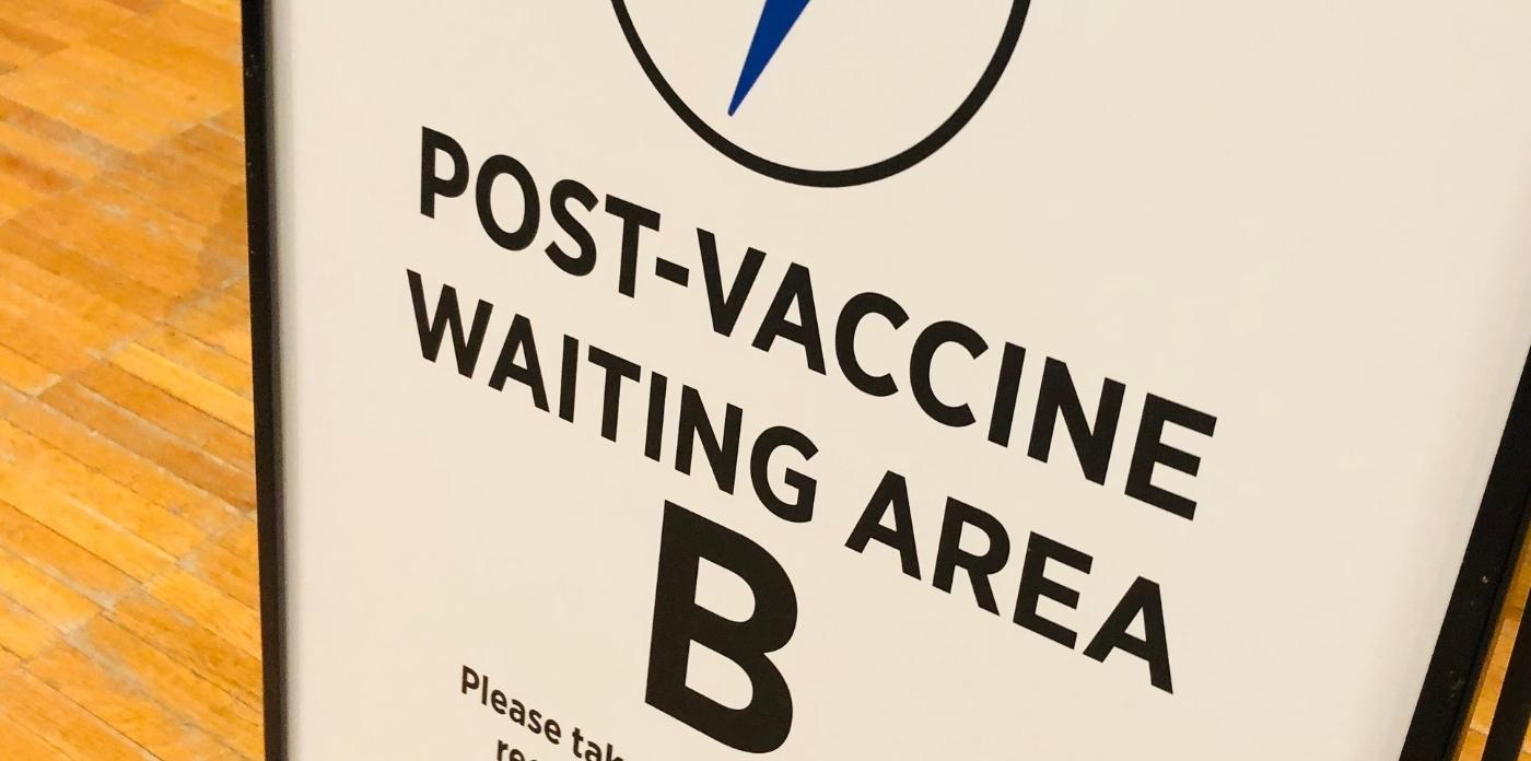 post vaccine waiting area sign